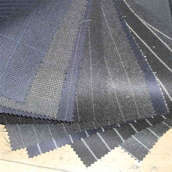 Village Tailors cloth samples for bespoke suits, jackets, trousers, shirts and coats