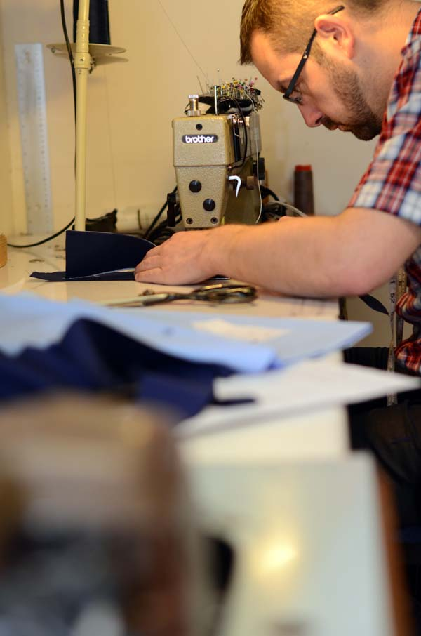 Tailor David Shane Moore working at a sewing machine